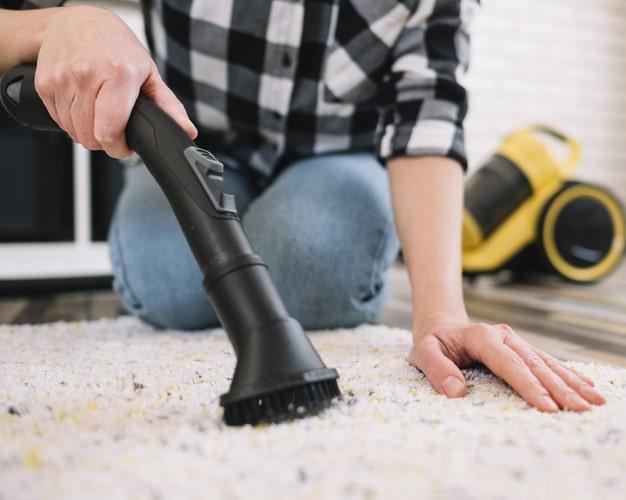 adult-vacuuming-carpet