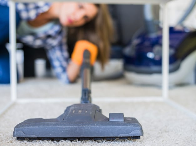close-up-housemaid-cleaning-carpet-with-vacuum-cleaner
