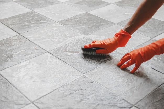 hand-man-wearing-orange-rubber-gloves-is-used-convert-scrub-cleaning-tile-floor