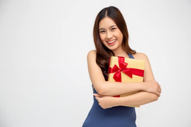 Happy beautiful woman smile with gold gift box