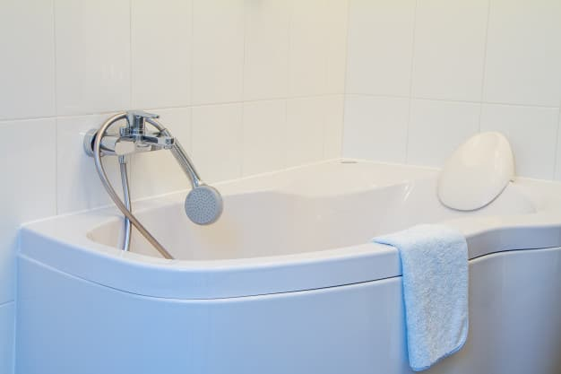 Modern corner bathrub with headrest faucet shower with long hose