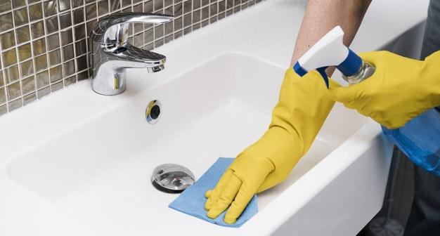 woman-cleaning-bathroom-sink