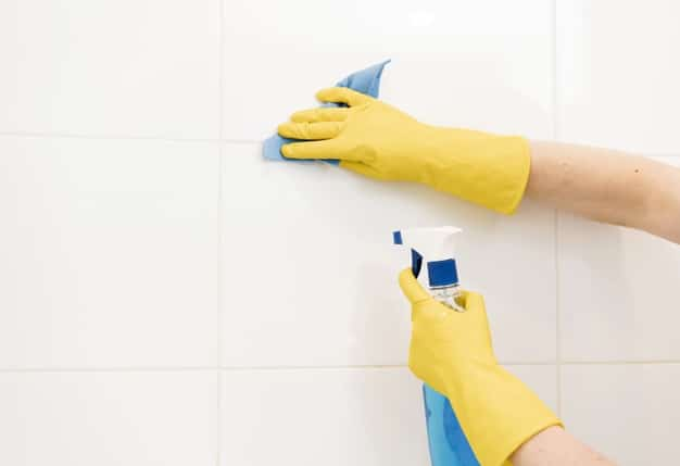 woman-cleaning-wall-tiles