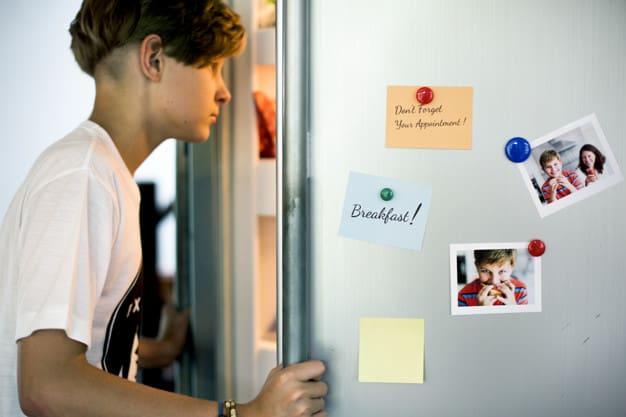 young caucasion boy open fridge