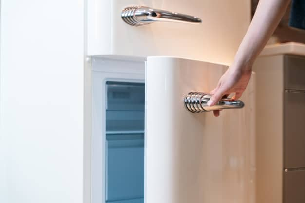 Hand open refrigerator door