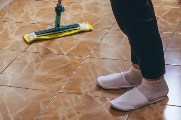 Mop the tiles to risen the floor