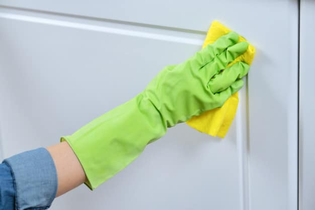 woman-gloves-with-rag-washing-cleaning-polishing-furniture-doors