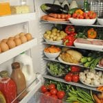 A full fridge with fruit, vegetables and meats