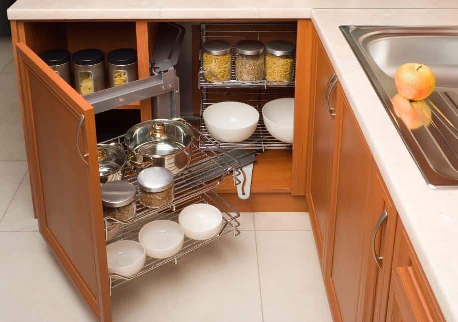 Light coloured wood kitchen cabinets filled with non-perishable food