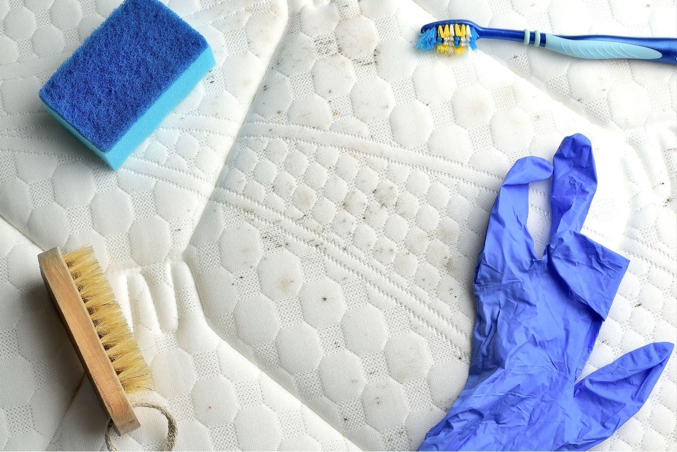 mattress cleaning equipment on a dirty white mattress