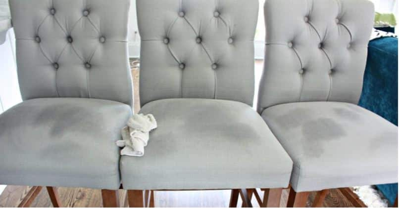 water drying on a grey upholstered chair