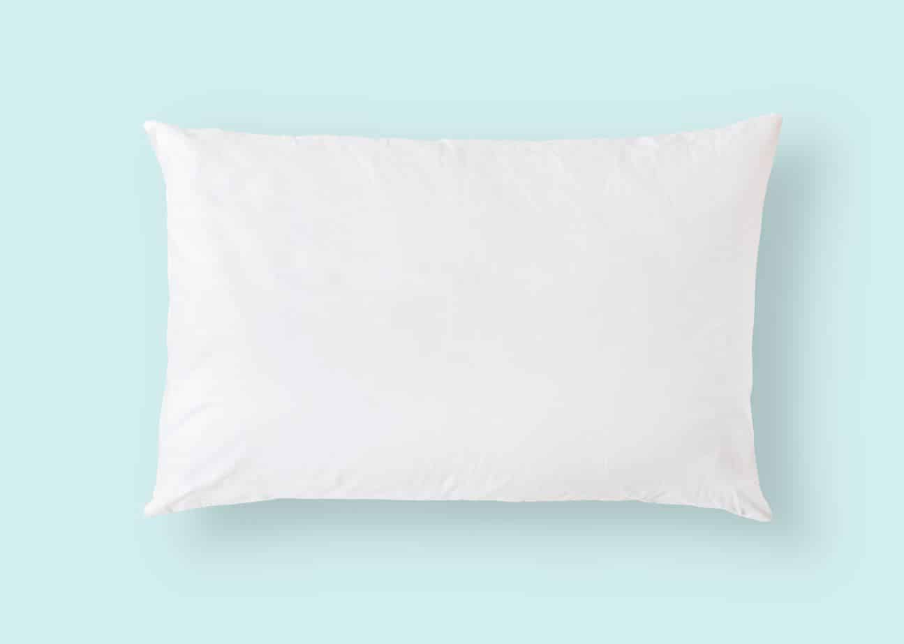 white pillow on a blue backdrop
