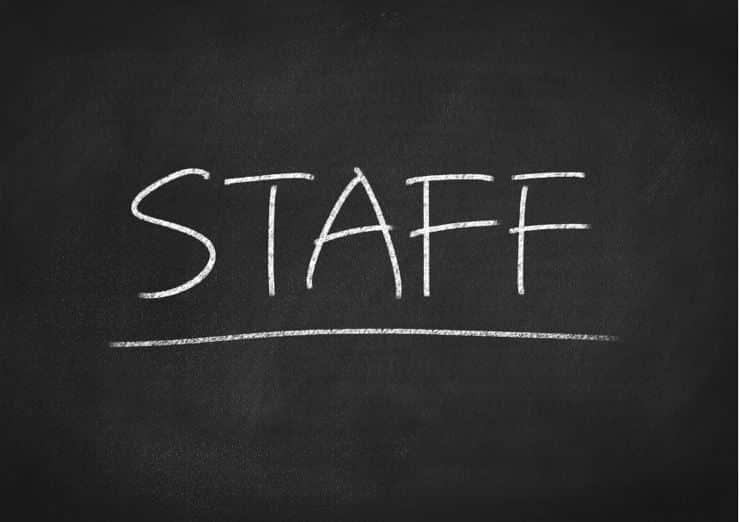 the word 'staff' on a blackboard written in chalk